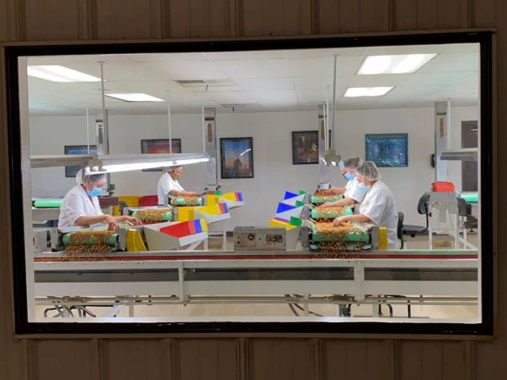 Employees at almond processing facilities